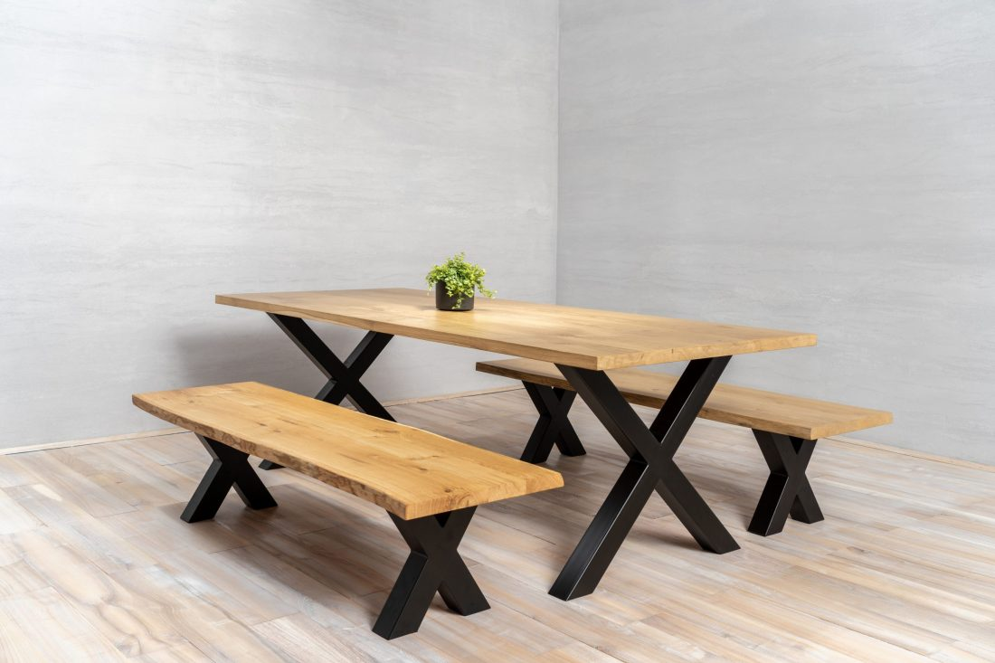 X-shaped oak dining table with metal legs